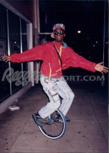 Andrew Tosh on his Unicycle