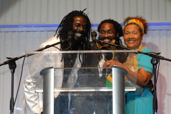 Buju Banton and Marcia Griffiths present Tarrus Riley with oneof his six Reggae Academy Awards