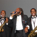 John Holt with 2 of the 5-piece horn section